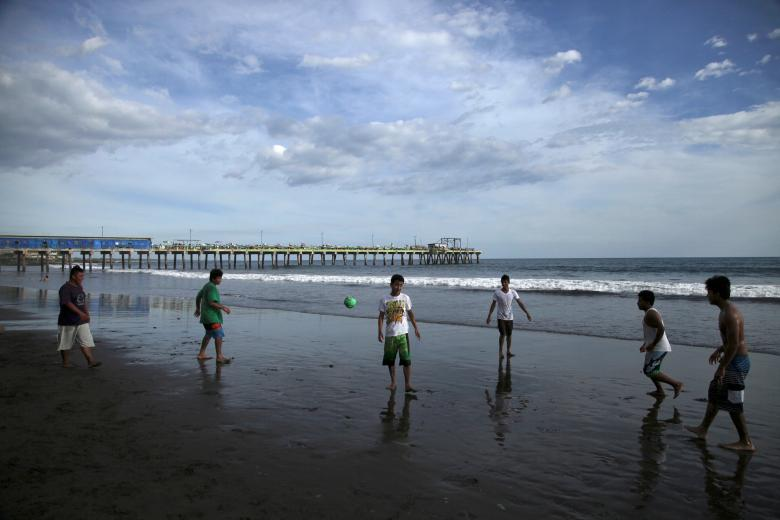 People play at La Pazon beach after a tsunami warning was lifted following a 7.0 magnitude undersea earthquake off the Pacific Coast of Central America, in La Libertad, El Salvador.