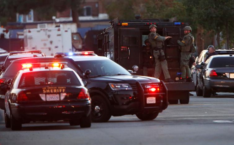 Police officers are seen at the scene of a shooting near a polling station, in Azusa, California, U.S.