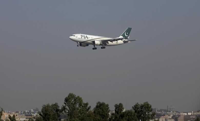 A Pakistan International Airlines (PIA) passenger plane arrives at the Benazir International airport in Islamabad, Pakistan.