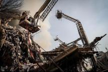 Rescue workers operate at the site of a collapsed high-rise building in Tehran, Iran.