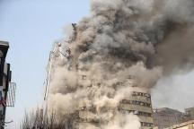 Smoke rises from a blazing high-rise building in Tehran, Iran.