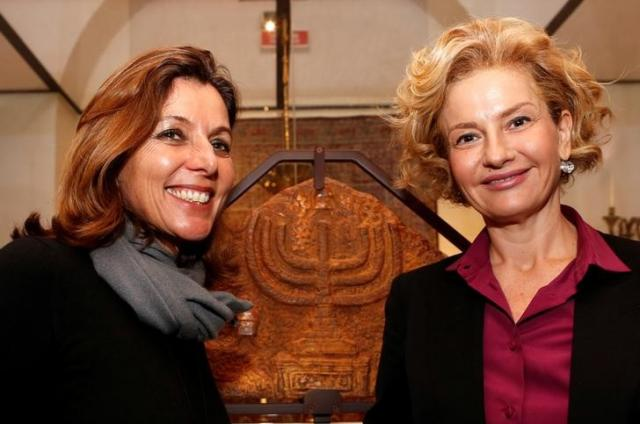 Vatican Museums Director Barbara Jatta (L) and Head of Rome's Jewish Museum Alessandra Di Castro (R) pose during a news conference where they presented an exhibition on the menorah, the ancient symbol of Judaism, at the Jewish Museum in Rome, Italy.