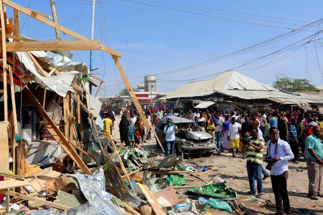 Civilians gather near the scene of a suicide bomb explosion at the Wadajir market in Madina district of Somalia's capital Mogadishu .