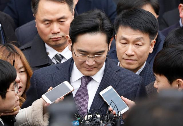 Samsung Group chief, Jay Y. Lee, leaves after attending a court hearing to review a detention warrant request against him at the Seoul Central District Court in Seoul, South Korea.