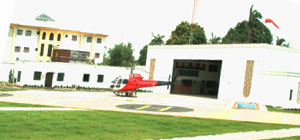 A helicopter landing on a helipad in the OAS Lagos base