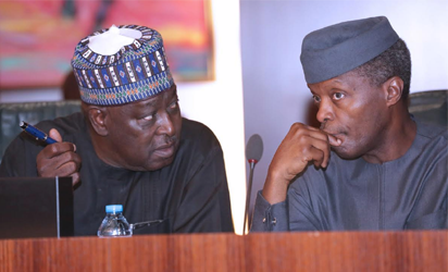 Acting President Yemi Osinbajo confers with SGF, Eng Babachir David Lawal as Acting President Presides over 4th FEC Meeting at the Council Chamber State House in Abuja.