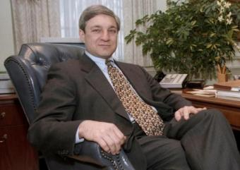 Penn State University President Graham Spanier poses in his office in the Old Main building in State College, Pennsylvania, in this February 26, 1997 file photo.