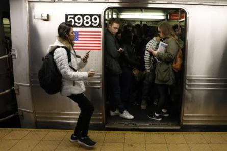 Passengers wait inside a stopped C subway train in New York City, U.S.