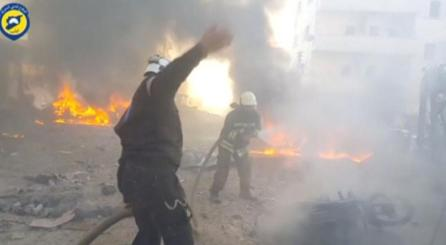 A still image taken from a video uploaded by White Helmets on June 24, 2017, shows civil defence members trying to put out a fire at the site of a car bomb, said to be in the town of al-Dana, in Syria's rebel-held Idlib province.