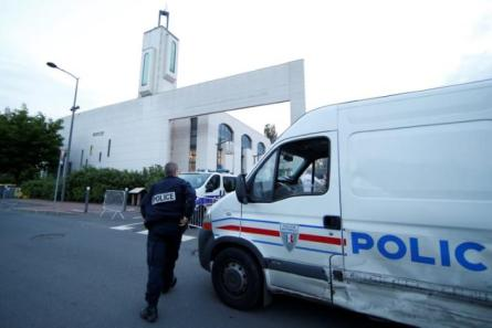 Police secure a mosque after a man was arrested after trying to drive a car into a crowd in front of the mosque in Creteil near Paris, France.