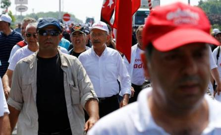 "Turkey's main opposition Republican People's Party (CHP) leader Kemal Kilicdaroglu walks during the 19th day of a protest, dubbed ""justice march"", against the detention of the party's lawmaker Enis Berberoglu, near Kocaeli, Turkey."