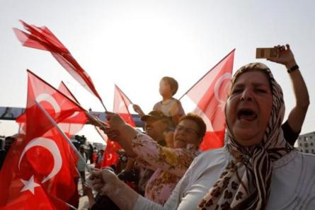 "Supporters of Turkey's main opposition Republican People's Party (CHP) leader Kemal Kilicdaroglu wave Turkish flags on the 19th day of a protest, dubbed ""justice march"", against the detention of the party's lawmaker Enis Berberoglu, near Izmit, Turkey."