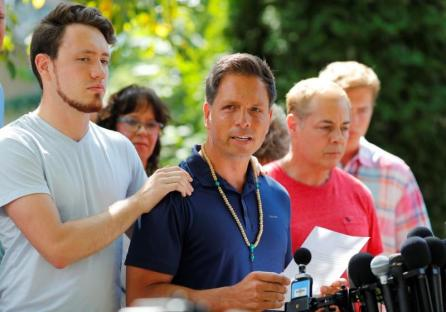 Don Damond is comforted by his son Zach Damond as he speaks to the media about his fiance, Justine Damond who was fatally shot by Minneapolis police in Minneapolis, Minnesota, U.S.