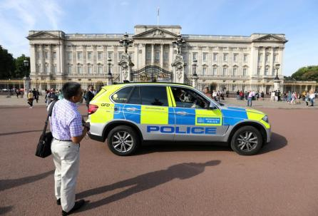 A police vehicle patrols outside Buckingham Palace in London, Britain.