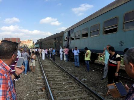 Egyptians look at the crash of two trains that collided near the Khorshid station in Egypt's coastal city of Alexandria, Egypt.