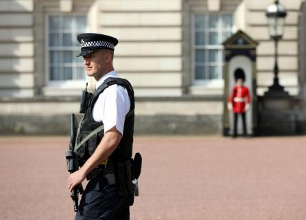 A police officer patrols within the grounds of Buckingham Palace in London, Britain.