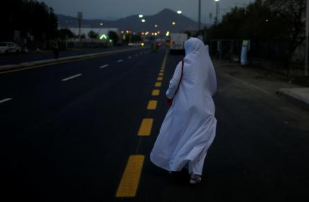 A pilgrim woman makes her way on the first day of the annual Haj pilgrimage in Arafat, Saudi Arabia.