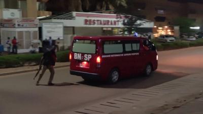 A fire brigade vehice departs following an attack by gunmen on a restaurant in Ouagadougou, Burkina Faso.