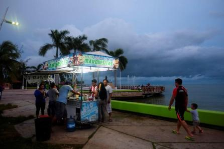 A street food stand is seen next to Chetumal Bay with heavy clouds caused by the proximity of the tropical storm Franklin to the coast of Quintana Roo, Mexico.