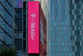 A T-Mobile logo is advertised on a building sign in Los Angeles, California, U.S.