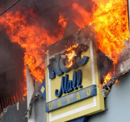 A fire rages at the NCCC shopping mall on Saturday, December 23, 2017, in Davao City.A fire rages at the NCCC shopping mall on Saturday, December 23, 2017, in Davao City.