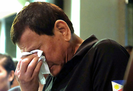 A man is seen weeping after a fire outbreak killed dozens at the NCCC shopping mall on Saturday, December 23, 2017, in Davao City.