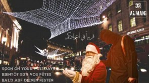 An ISIS propaganda poster show Santa kneeling in front of a terrorist with London's Regent Street in the background.