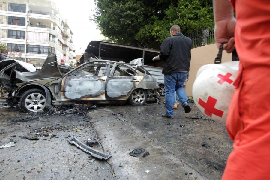 A damaged car is seen in Sidon