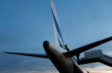 Man inspects a plane damaged during clashes at Mitiga airport in Tripoli, Libya.