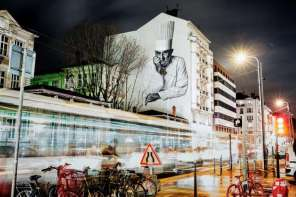 A painted mural of French chef Paul Bocuse is seen on the side of a building in Lyon, France.