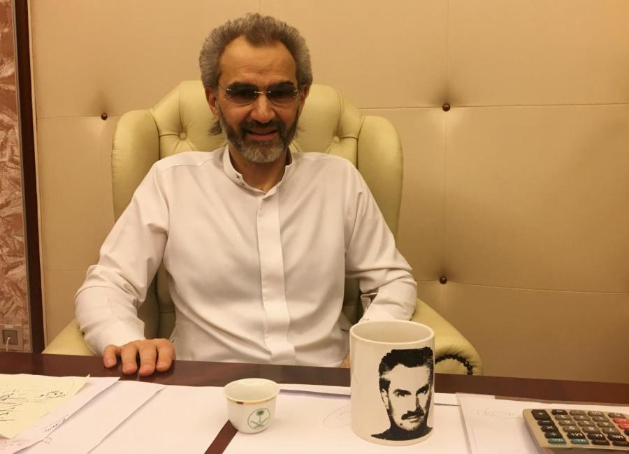 Saudi Arabian billionaire Prince Alwaleed bin Talal sits for an interview in the office of the suite where he has been detained at the Ritz-Carlton in Riyadh, Saudi Arabia