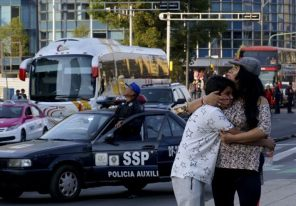 A woman hugs her son following an earthquake in Mexico City, Mexico.