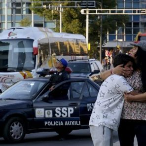 A woman hugs her son following an earthquake in Mexico City, Mexico.