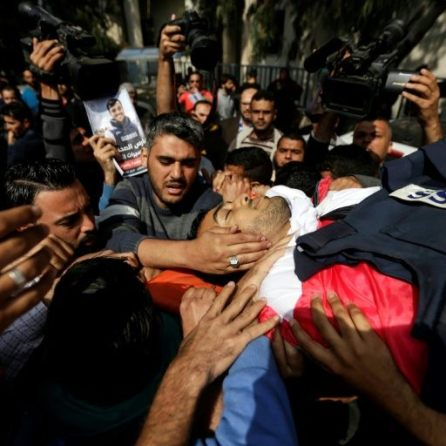 Palestinians evacuate mortally wounded Palestinian journalist Yasser Murtaja during clashes with Israeli troops at the Israel-Gaza border, in the southern Gaza Strip.