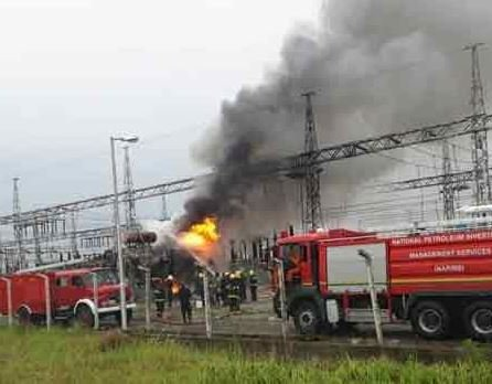 Fire Service officials are seen at scene of a fire incident at the Alagbon Injection Station in Lagos, Nigeria.