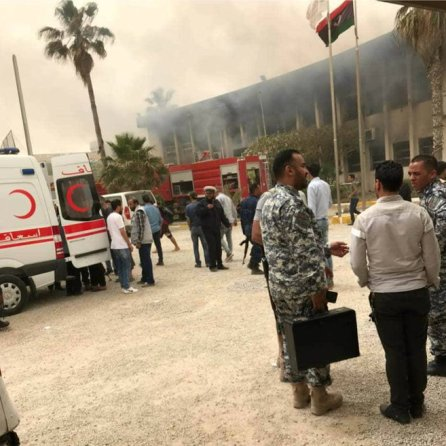 Emergency personnel are seen outside the electoral commission headquarters following suicide attacks in Tripoli, Libya.
