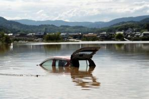 A car is submerged at a flooded area in Mabi town in Kurashiki, Okayama Prefecture, Japan.