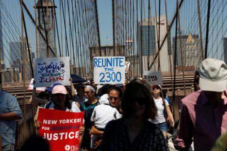 Demonstrators march on Brooklyn Bridge during 'Keep Families Together' march to protest Trump administration's immigration policy in New York, U.S.