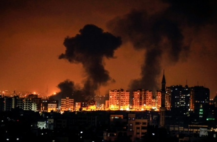 Smoke plumes are seen rising following an Israeli airstrike on Gaza City.