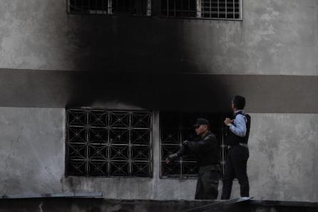 Security forces check a nearby building after an explosion was heard while President Nicolas Maduro was giving a speech during an anniversary ceremony of the National Guard in Caracas, Venezuela.