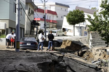People look at an area damaged by an earthquake in Sapporo in Japan's northern island of Hokkaido, Japan.