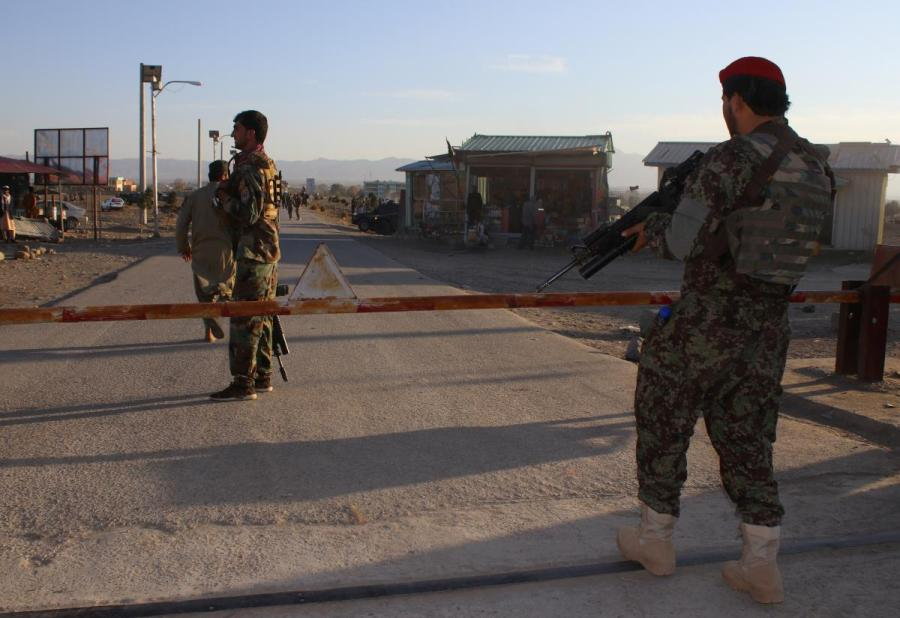 Afghan National Army (ANA) soldiers stand guard at the gate of an army base after a suicide blast in Khost province, Afghanistan
