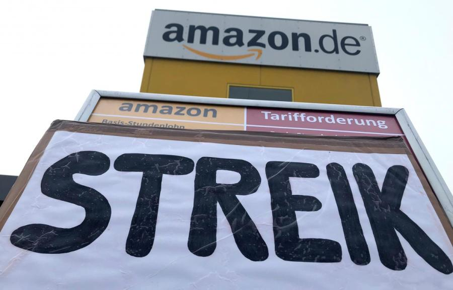 A placard calls on workers at an Amazon logistics center to go on strike in Bad Hersfeld