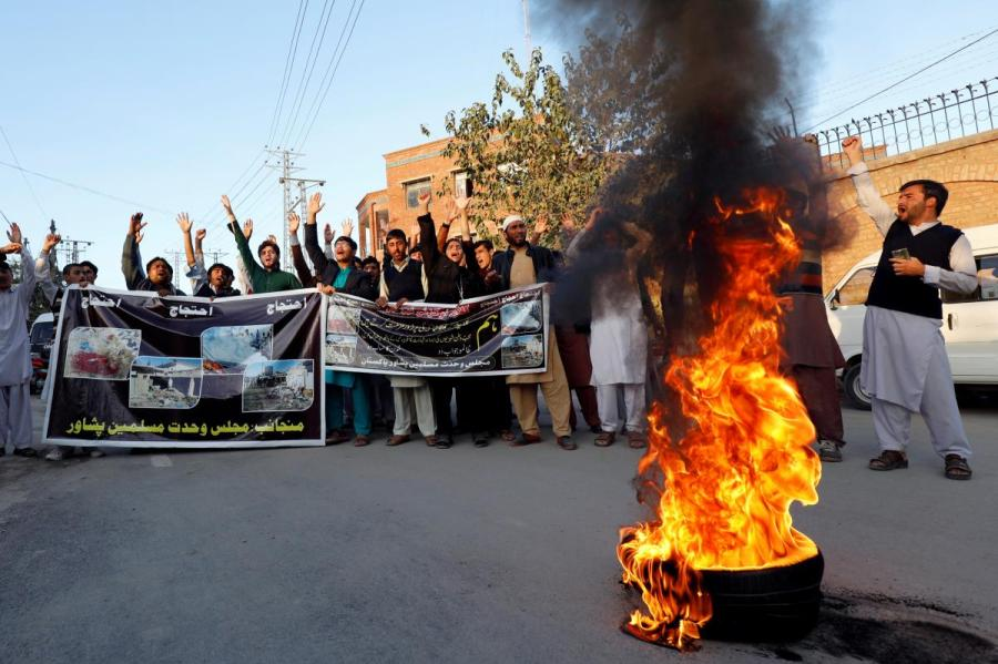 Supporters of MWM a religious group chant slogans to protest against the blast in Orakzai, during a protest in Peshawar