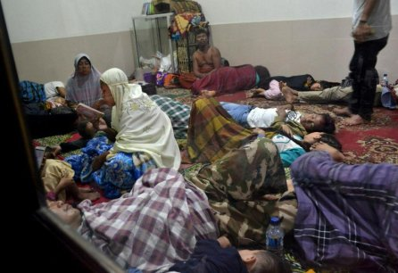 Residents sit inside a mosque as they are evacuated following high waves and the eruption of Anak Krakatau volcano at Labuan district in Pandeglang regency, Banten province, Indonesia.