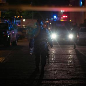 Police officers walk at a crime scene following a deadly attack at a bar by unknown assailants in Coatzacoalcos, Mexico.