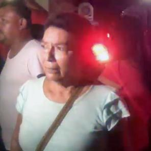 A woman waits for news about her son at the scene of an arson attack in Coatzacoalcos, Mexico in this still image obtained from social media video.