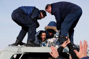 Specialists help Roscosmos cosmonaut Alexander Skvortsov shortly after landing of the Russian Soyuz MS-13 space capsule in a remote area southeast of Zhezkazgan in the Karaganda region of Kazakhstan.