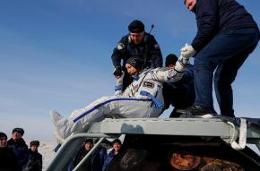 Specialists help ESA (European Space Agency) astronaut Luca Parmitano shortly after landing of the Russian Soyuz MS-13 space capsule in a remote area southeast of Zhezkazgan in the Karaganda region of Kazakhstan.