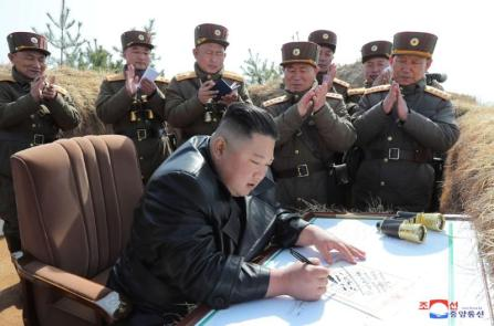 North Korean leader Kim Jong Un guides artillery fire competition in this image released by North Korea's Korean Central News Agency (KCNA).